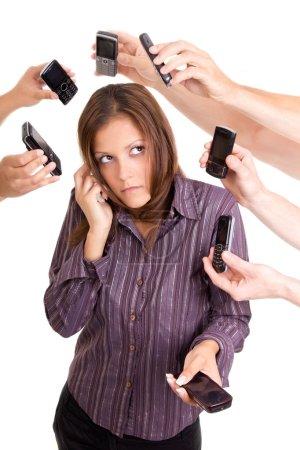 Foto de Mujer de negocios serán incapaces de responder a todas las llamadas - Imagen libre de derechos