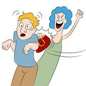 An image of a angry woman hitting a man with her purse