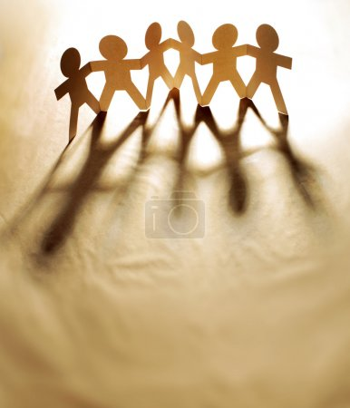 Photo for Group of papechain holding hands together - Royalty Free Image