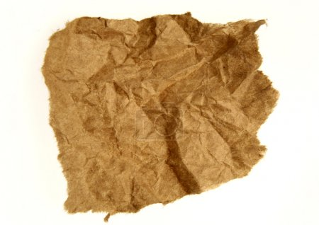 Piece of ripped brown paper on white