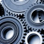Steel gears meshing together...