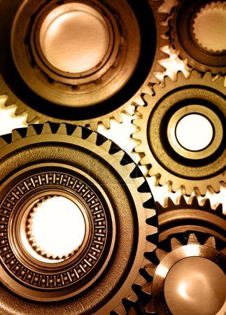 Closeup of steel gears joining together