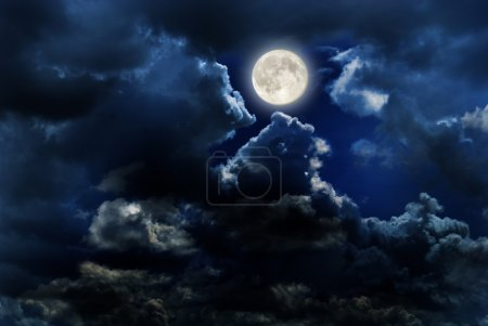 Photo for Full moon over dark sky with. - Royalty Free Image