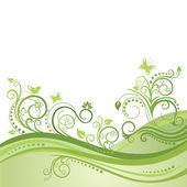 Zöld tavaszi mező, a virágok és a pillangók