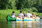 Three canoe boats on river