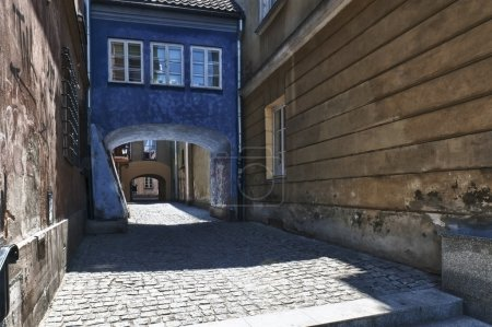 Archway at tenement house at Warsaw's old town.
