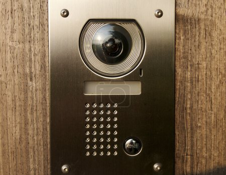 Door intercom with camera on wood