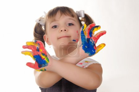 Little girl with hands soiled
