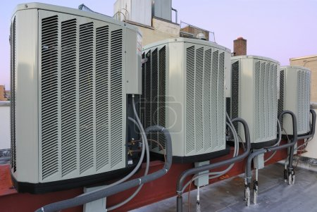 Photo for A row of air conditioning units on a rooftop. - Royalty Free Image