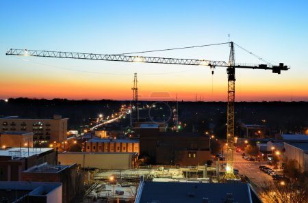 Photo for Construction crane over a city - Royalty Free Image