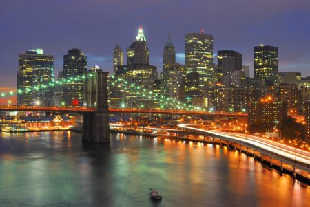 Photo for The Brooklyn Bridge Juxtaposed against the downtown New York City Skyline. - Royalty Free Image