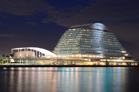 Photo for Kobe, Japan - July 8, 2011: Kobe Meriken Park Oriential Hotel is an iconic building in Harborloand and is designed to resemble a liuxury liner. - Royalty Free Image