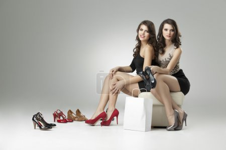 Photo for Two glamorous women shopping high heels - Royalty Free Image