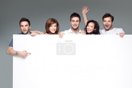 Photo for Group of funny friends holding a blank banner - Royalty Free Image