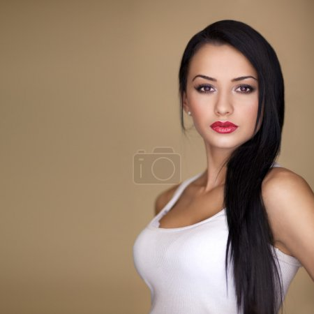 Photo for Long hair brunette model posing beauty at camera - Royalty Free Image