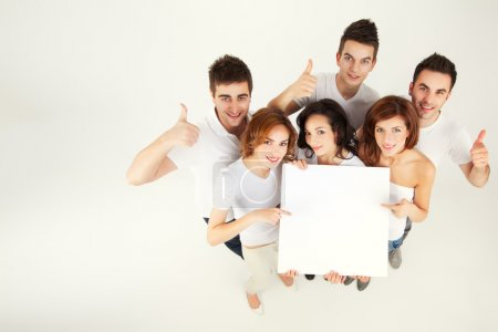 Photo for Team of casual young holing blank banner - Royalty Free Image