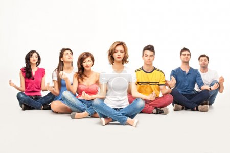 Young casual at yoga course