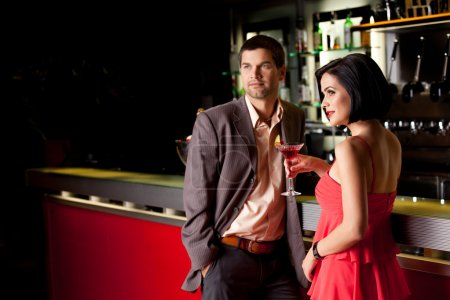 Photo for Young couple bar counter having drinks - Royalty Free Image