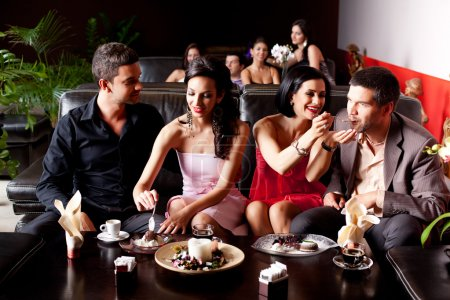 Photo for Young couples eating deserts feeding each other - Royalty Free Image