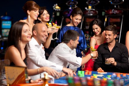 Photo for Friends drinking and celebrating a gambling night - Royalty Free Image