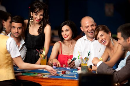 Photo for Happy and dealer playing blackjack - Royalty Free Image