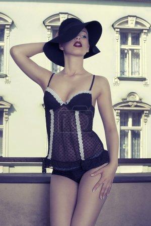 Elegant beautiful woman wearing a black fashion hat