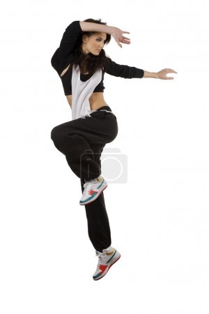 Photo for Modern young woman dancer in hip hop style taking pose and jumping over white background - Royalty Free Image