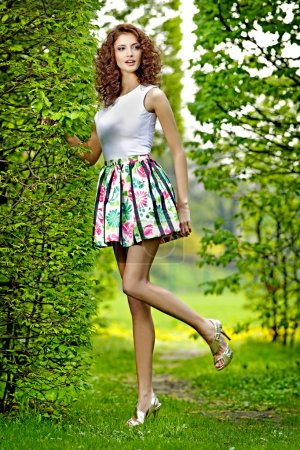 Photo for Beautiful brunette in the garden - Royalty Free Image