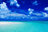 Beach with blue sky and vibrant ocean colors