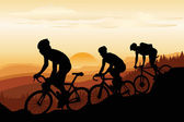 A vector illustration of a group of mountain bikers