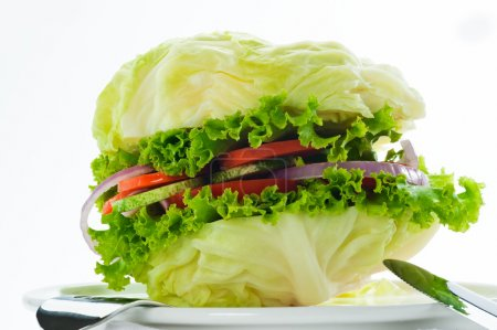Photo for Vegetarian burger - cabbage, tomato, cucumber, onion, lettuce - Royalty Free Image