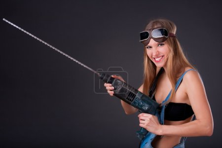 Girl with a drill