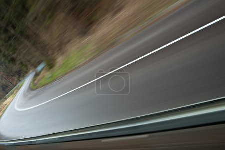Velocity - winding road (the image is intentionally motion blurr