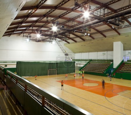 Interior of a modern multifunctional gymnasium with young