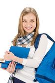 mujer adolescente estudiante con mochila sostener libros