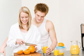 Breakfast happy couple make orange juice morning