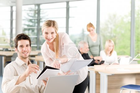 Student businesspeople having meeting in office