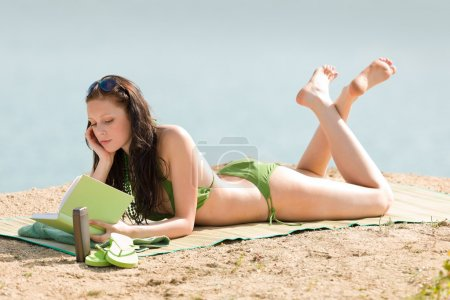 Summer beach woman relax with book bikini
