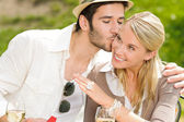 Happy woman receiving wedding ring sunny terrace