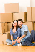 Moving new home young couple sitting floor