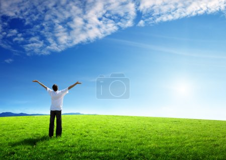 Photo for Happy young man on green field - Royalty Free Image
