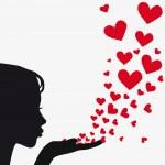 Woman silhouette hand. Pretty girl blowing heart. ...