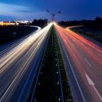 Light trails of evening highway. Urban background...