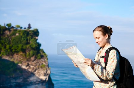 Photo for Girl tourist read the map - Royalty Free Image