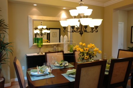Lovely dining room layout with contemporary chande...