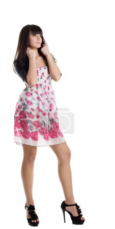 Young beauty brunette in summer dress and jacket
