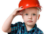 Little boy in a red construction helmet