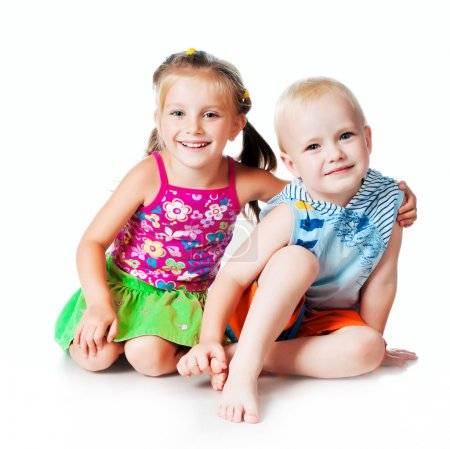 Photo for Little brother and sister on a white background - Royalty Free Image