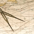 A compass and map showing shipping routes...