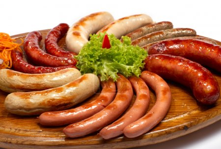 A set of different sausages, grilled on wooden plate